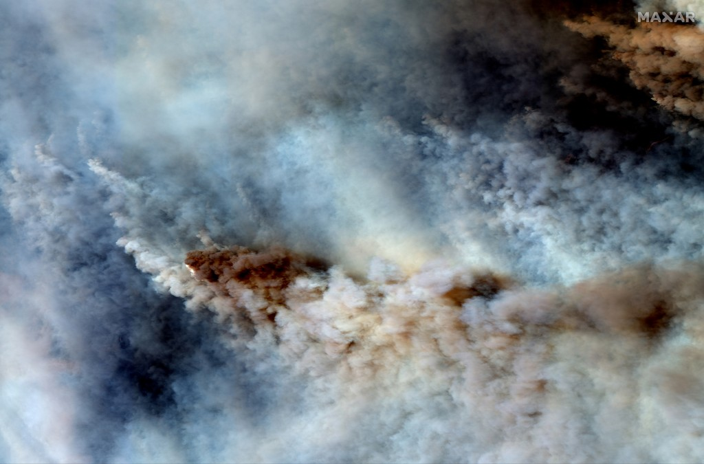 This Saturday, Jan. 4, 2019 image provided by provided by Maxar Technologies shows wildfires east of Orbost , Australia.  Australia's prime minister c...