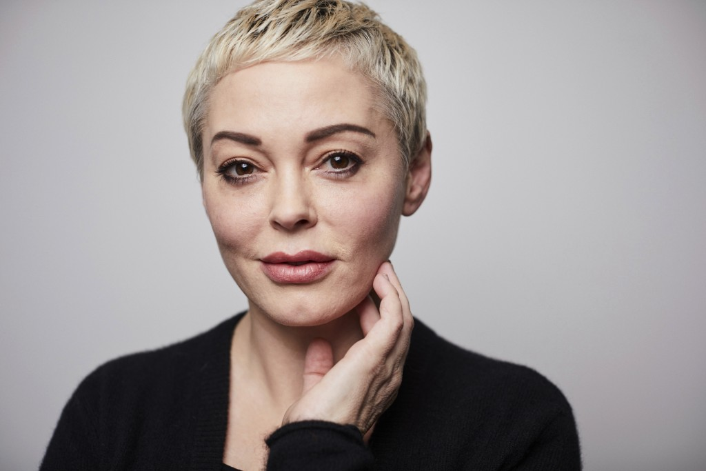 """Rose McGowan poses for a portrait in New York on Friday, Jan. 3, 2020.  McGowan's says her tweet that apologized on behalf of the U.S. to Iran for """"di..."""