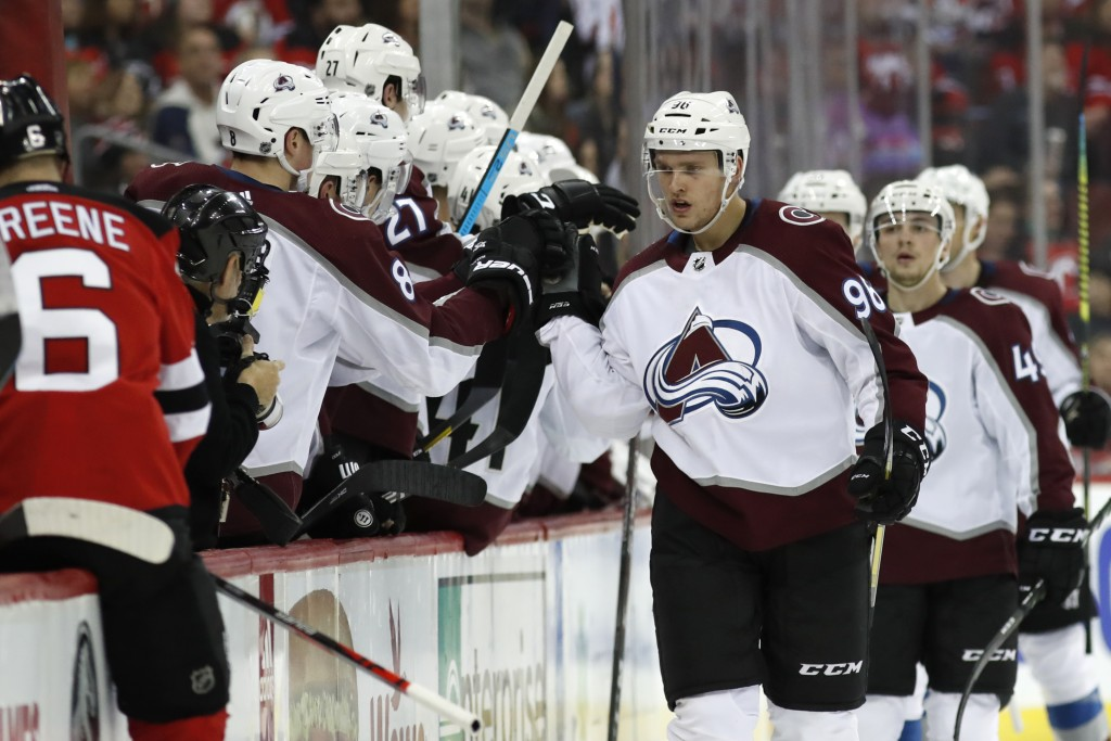 Teammates congratulate Colorado Avalanche right wing Mikko Rantanen (96,) of Finland, after he scored a goal during the second period of the team's NH...