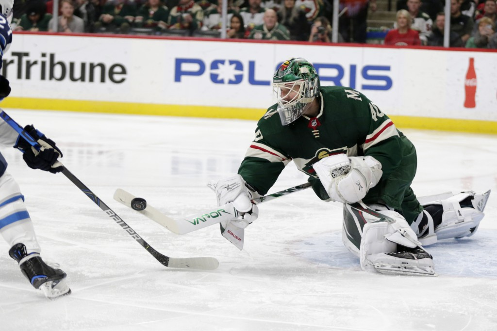 Minnesota Wild goalie Deva Dubnyk makes a save against Winnipeg Jets left wing Nikolay Ehlers (27) in the second period of an NHL hockey game Saturday...