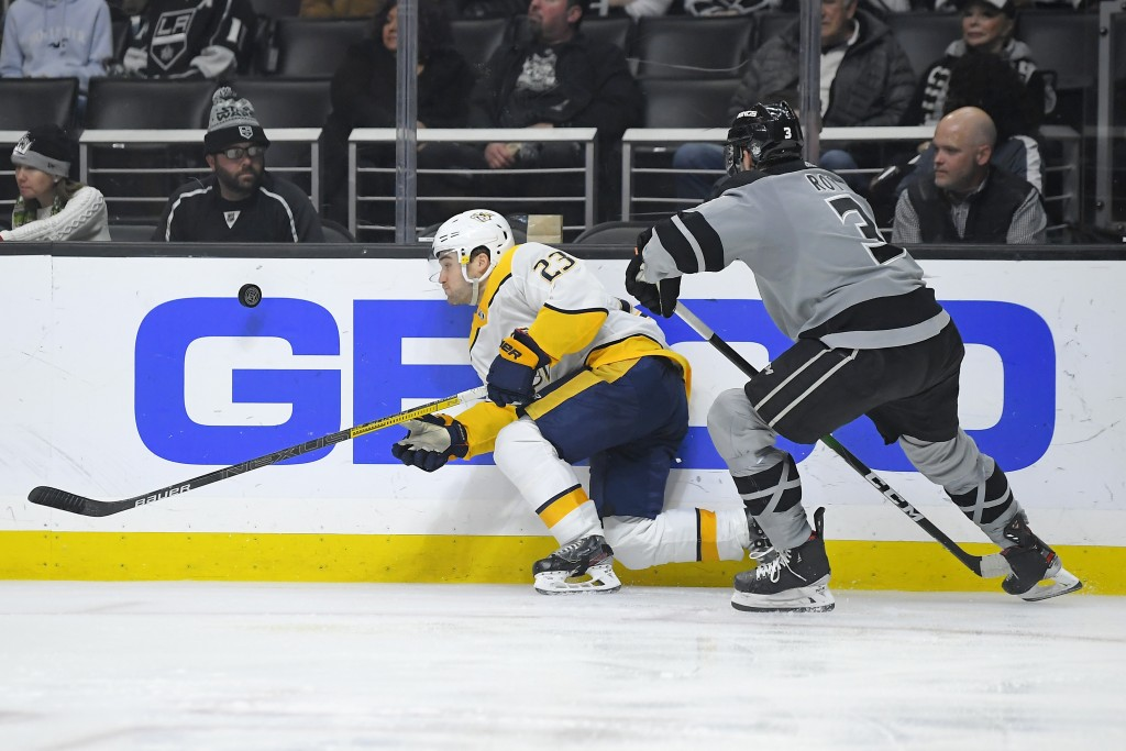 Nashville Predators right wing Rocco Grimaldi, left, and Los Angeles Kings defenseman Matt Roy vie for the puck during the third period of an NHL hock...