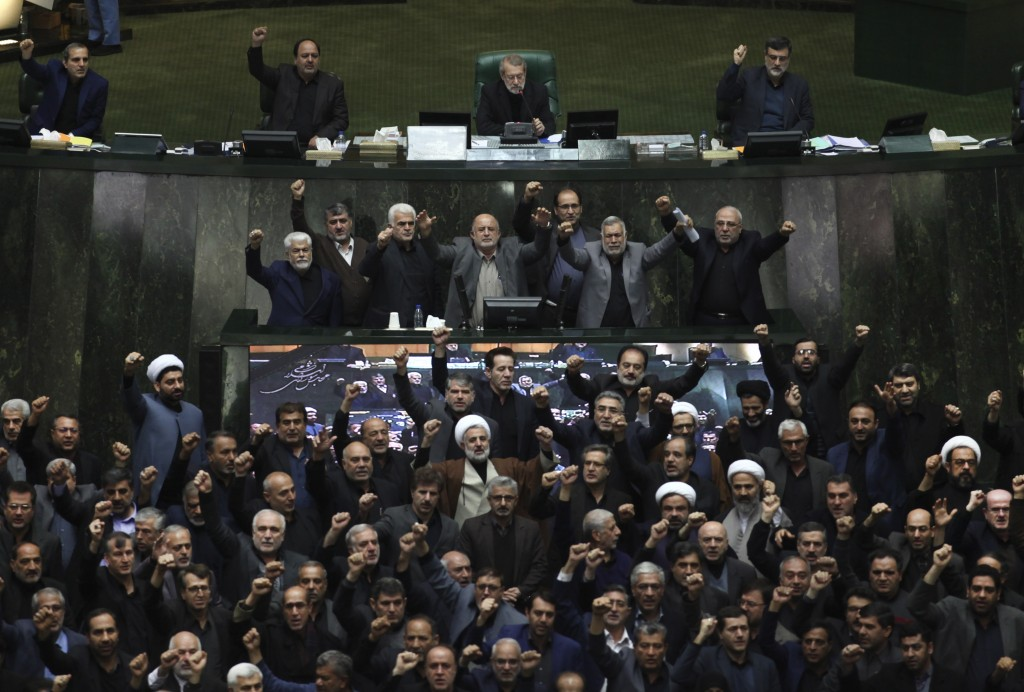 Iranian lawmakers chant anti-American and anti-Israeli slogans to protest against the U.S. killing of Iranian top general Qassem Soleimani, at the sta...