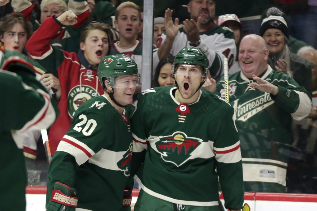 Minnesota Wild left wing Marcus Foligno (17) celebrates defenseman Ryan Suter (2) after scoring a goal against the Winnipeg Jets in the first period o...