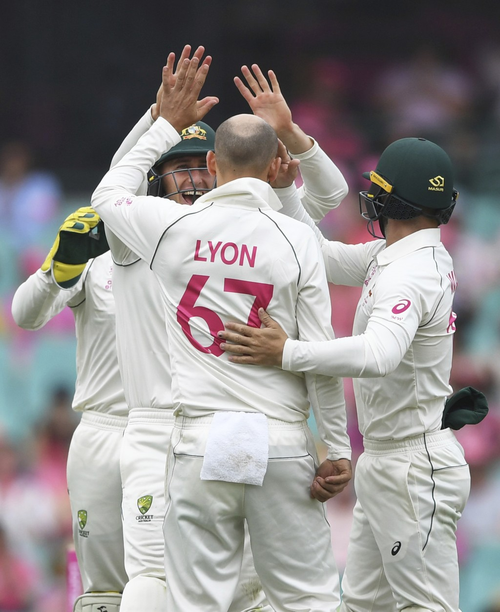 Australia's Nathan Lyon (67) is celebrated by teammates after bowling New Zealand's Tom Blundell on day three of the third cricket test match between ...