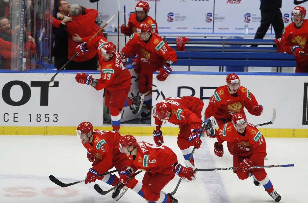 Russia's players celebrate after winning the U20 Ice Hockey Worlds semifinal match between Sweden and Russia in Ostrava, Czech Republic, Saturday, Jan...