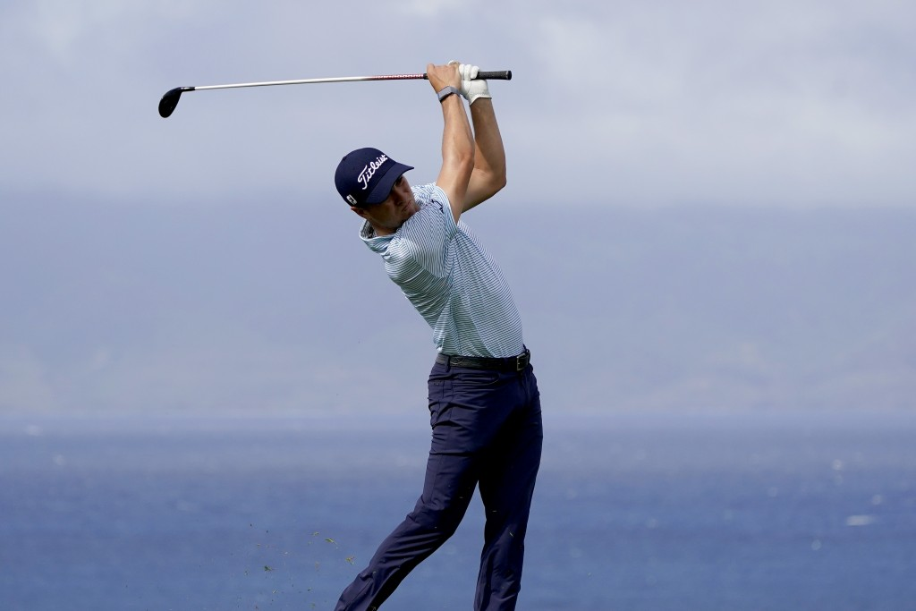 Justin Thomas hits from the 13th tee during third round of the Tournament of Champions golf event, Saturday, Jan. 4, 2020, at Kapalua Plantation Cours...