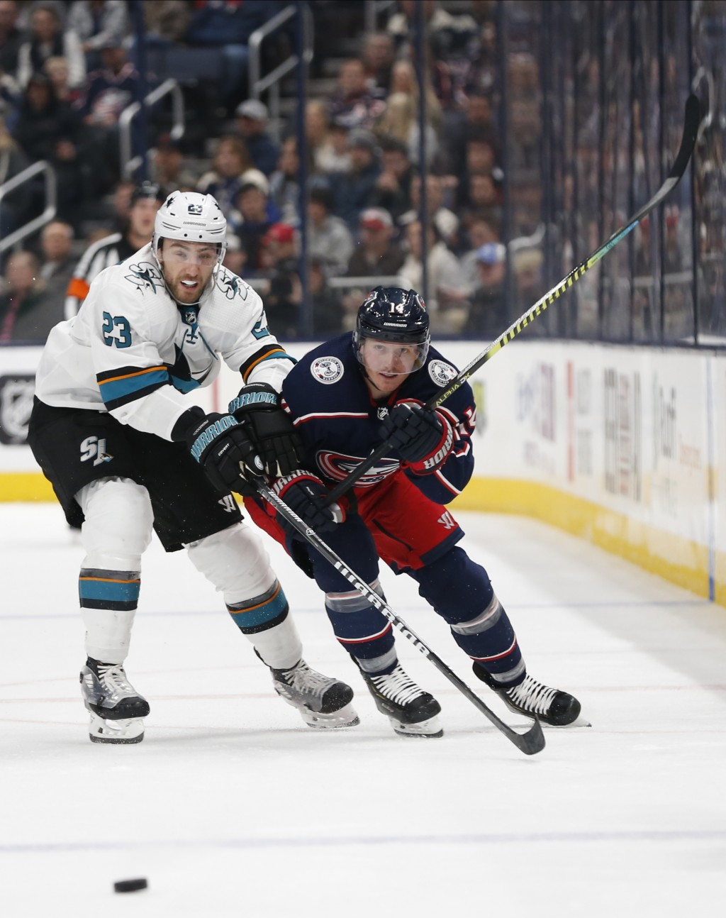 San Jose Sharks' Barclay Goodrow, left,and Columbus Blue Jackets' Gustav Nyquist, of Sweden, chase a loose puck during the second period of an NHL hoc...