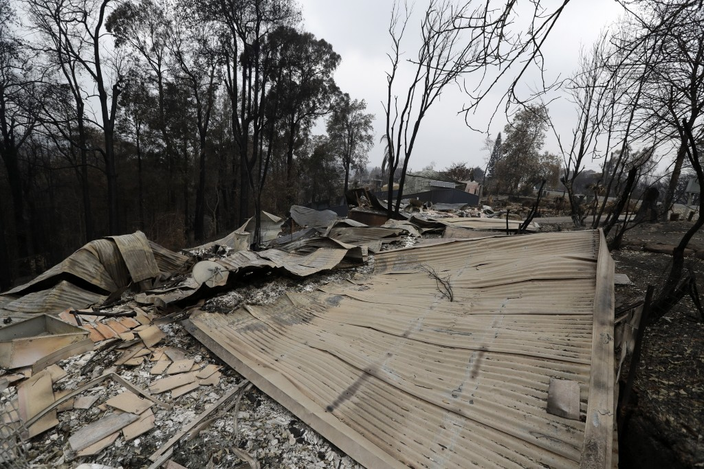 Houses are flattened at Conjola Park, Australia, Sunday, Jan. 5, 2020, after recent wildfires ripped through the community. The deadly wildfires, whic...