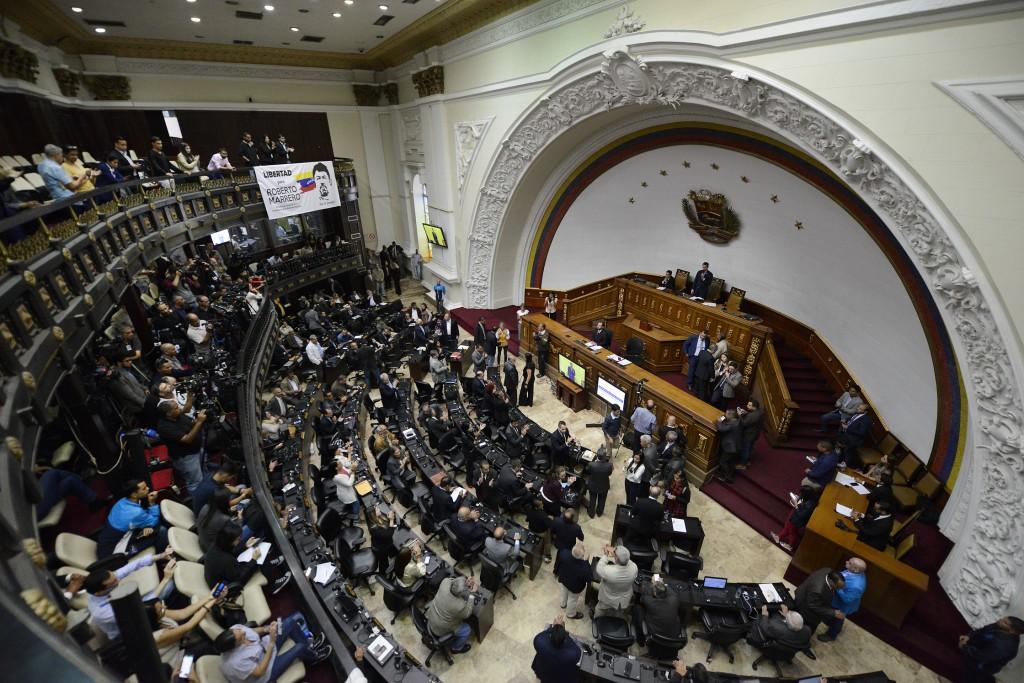 FILE - In this Dec. 17, 2019 file photo, Venezuelan Opposition leader and self-proclaimed interim president of Venezuela Juan Guaido speaks during an ...