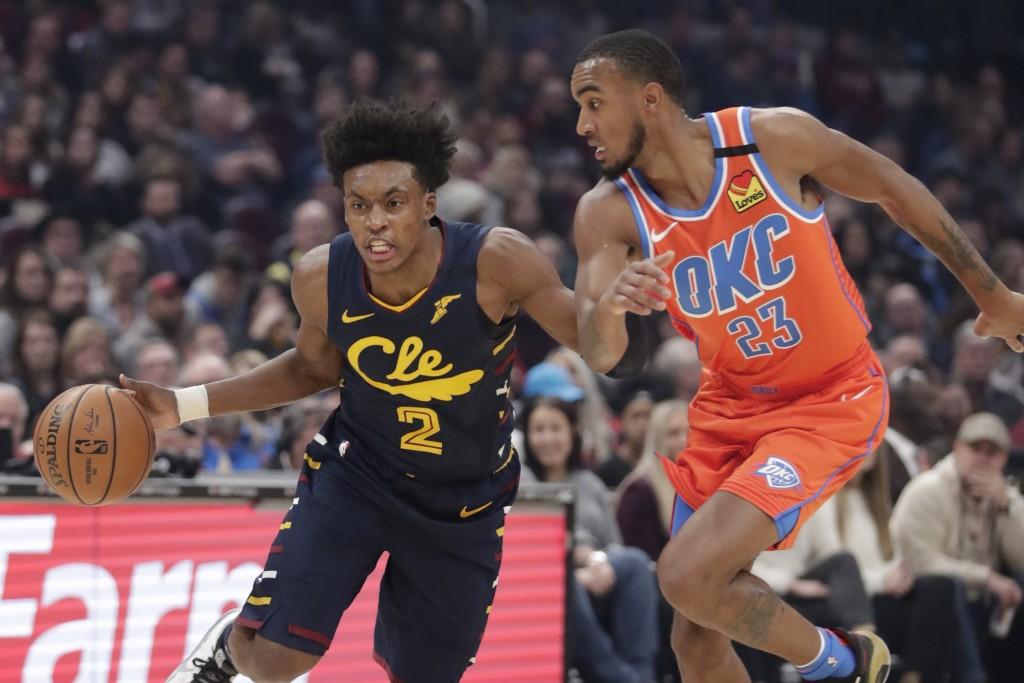 Cleveland Cavaliers' Collin Sexton (2) drives past Oklahoma City Thunder's Terrance Ferguson (23) in the first half of an NBA basketball game, Saturda...