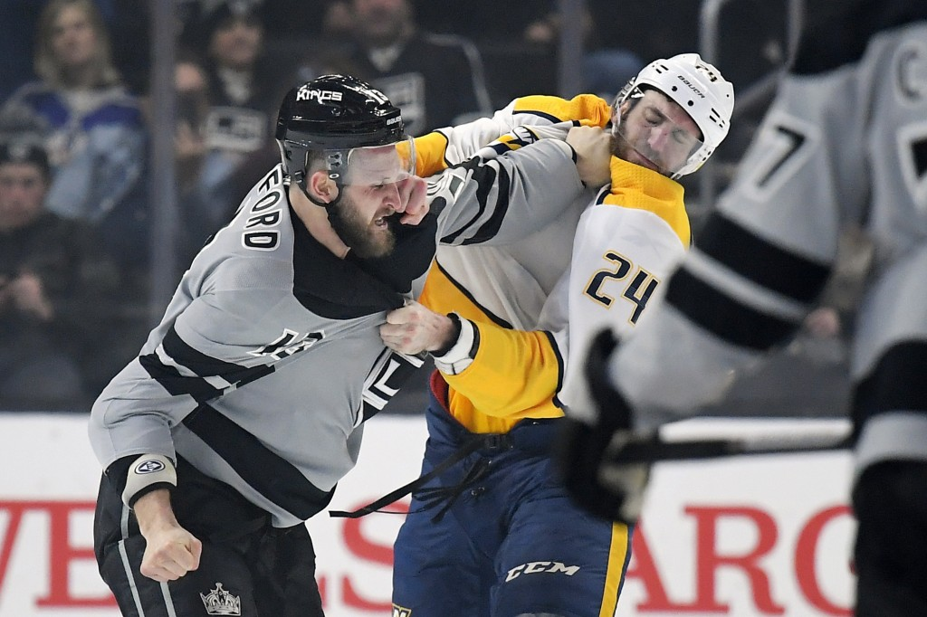 Los Angeles Kings left wing Kyle Clifford, left, fights with Nashville Predators defenseman Jarred Tinordi during the first period of an NHL hockey ga...
