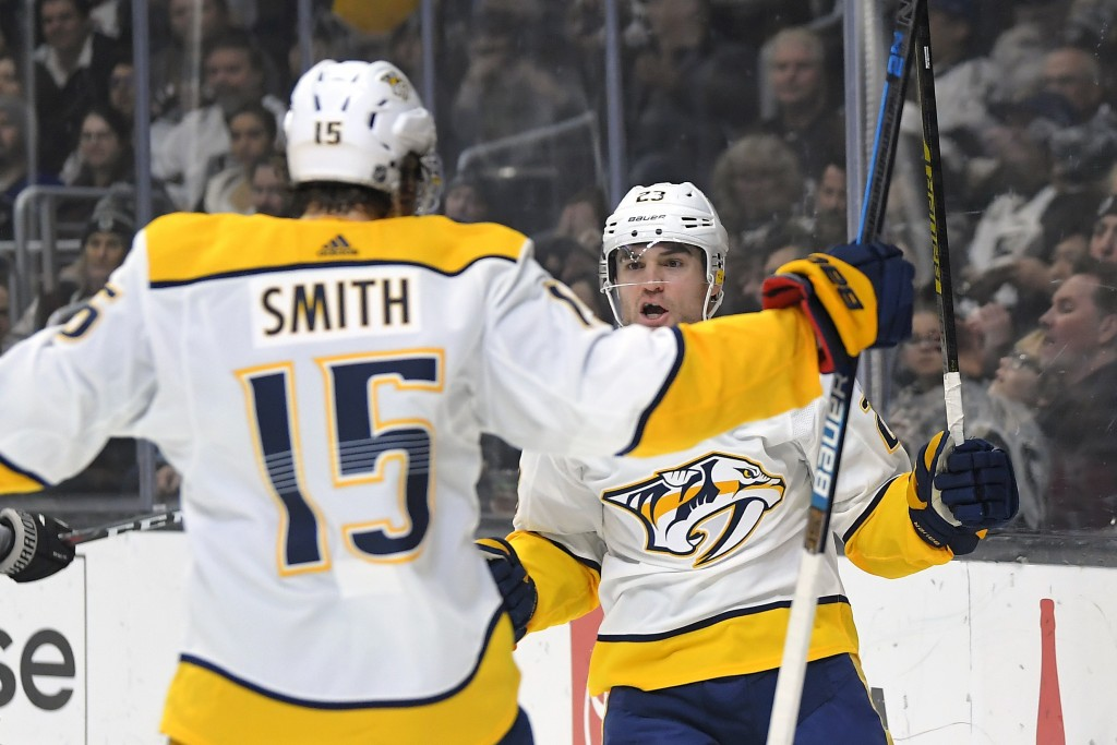 Nashville Predators right wing Rocco Grimaldi, right, celebrates his goal with right wing Craig Smith during the first period of the team's NHL hockey...