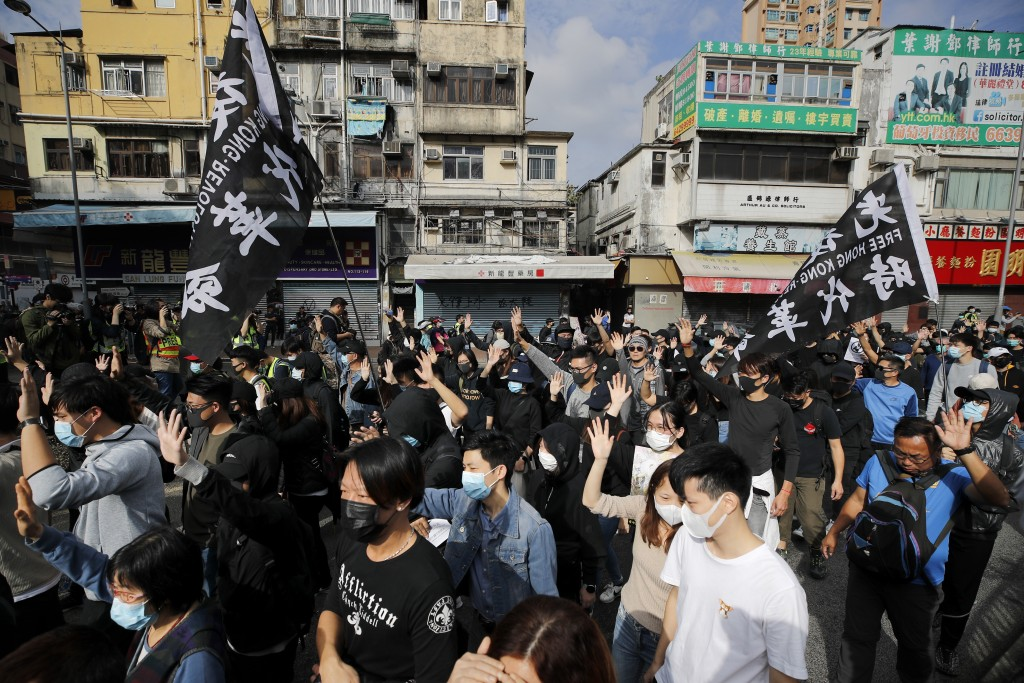 "Protesters march during a demonstration against ""parallel traders"" who buy goods in Hong Kong to resell in mainland China in Sheung Shui, near the Chi..."