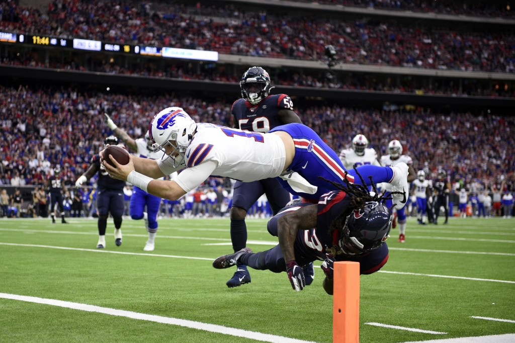 Buffalo Bills quarterback Josh Allen (17) dives to score a touchdown after catching a pass as Houston Texans strong safety Jahleel Addae (37) defends ...
