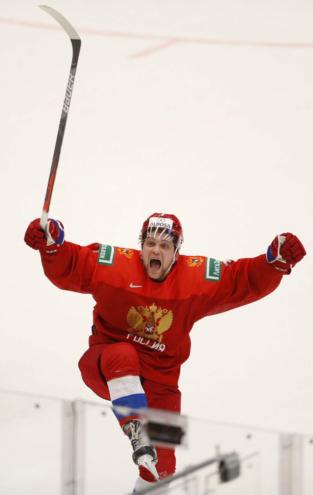 Russia's Alexander Khovanov celebrates after winning the U20 Ice Hockey Worlds semifinal match between Sweden and Russia in Ostrava, Czech Republic, S...
