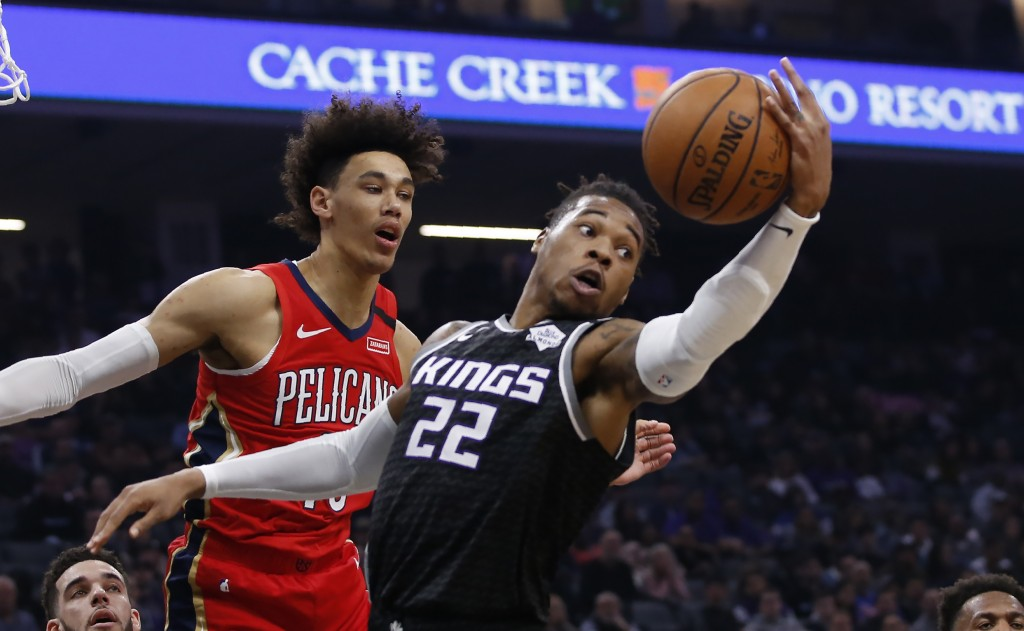 Sacramento Kings forward Richaun Holmes, right, grabs a rebound next to New Orleans Pelicans center Jaxson Hayes during the first quarter of an NBA ba...