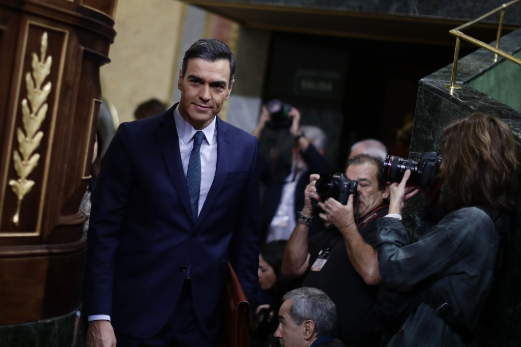 Spain's caretaker Prime Minister Pedro Sanchez arrives at the Spanish Parliament in Madrid, Spain, Sunday, Jan. 5, 2020. Sanchez is not expected to cl...