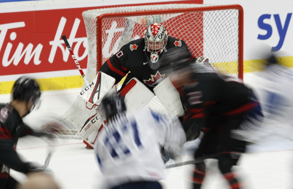 In this picture taken with slow shutter speed Canada's goaltender Joel Hofer concentrates during the U20 Ice Hockey Worlds semifinal match between Fin...