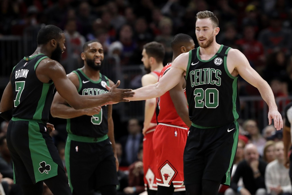 Boston Celtics forward Gordon Hayward, right, celebrates with forward Jaylen Brown after scoring a basket during the first half of the team's NBA bask...