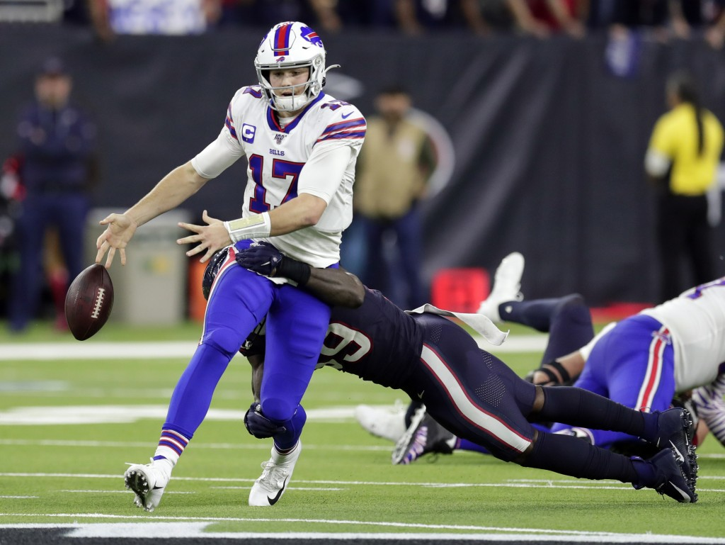 Buffalo Bills quarterback Josh Allen (17) fumbles the ball as he is hit by Houston Texans outside linebacker Whitney Mercilus during the second half o...