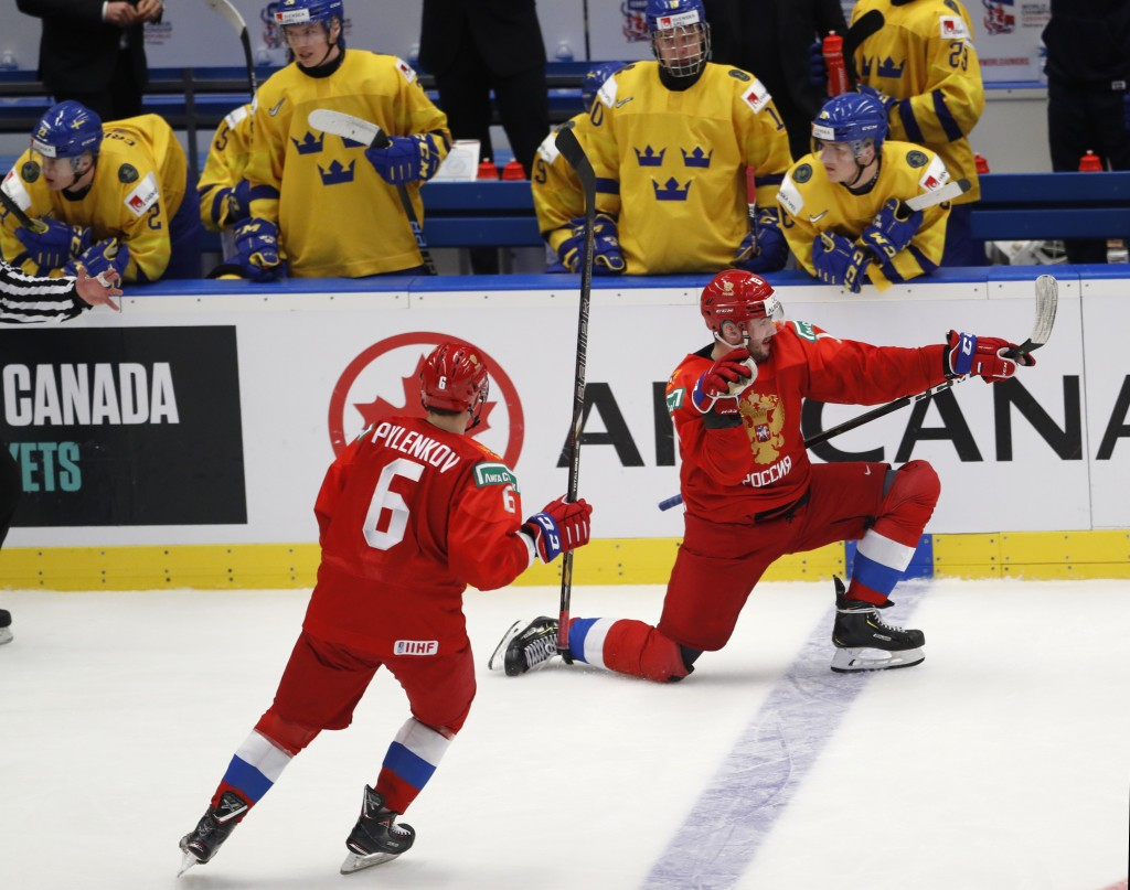 Russia's Yegor Sokolov, right, celebrates with Russia's Danil Pylenkov after scoring his sides fourth goal during the U20 Ice Hockey Worlds semifinal ...