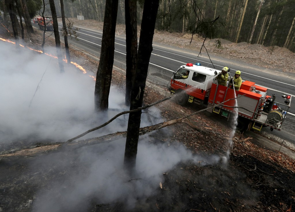 Firefighters manage a controlled burn to help contain a larger fire near Falls Creek, Australia, Sunday, Jan. 5, 2020. The deadly wildfires, which hav...