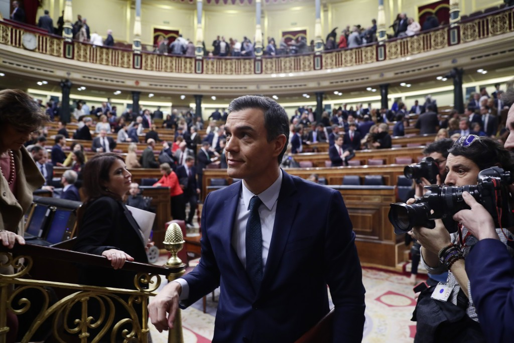 Spain's interim Prime Minister Pedro Sanchez leaves the Spanish Parliament in Madrid, Spain, Sunday, Jan. 5, 2020. Sanchez has failed on his first two...