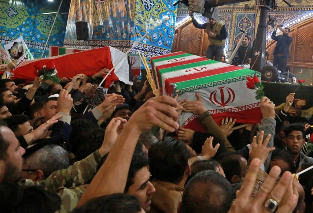 Mourners carry the coffins of Iran's top general Qassem Soleimani and Abu Mahdi al-Muhandis, deputy commander of Iran-backed militias in Iraq known as...