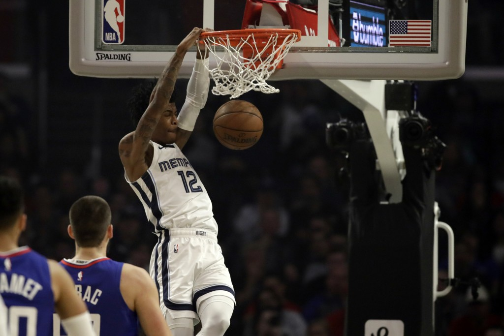 Memphis Grizzlies' Ja Morant (12) dunks against the Los Angeles Clippers during the first half of an NBA basketball game Saturday, Jan. 4, 2020, in Lo...