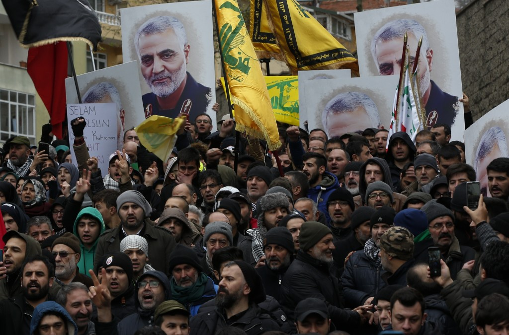 Protesters chant anti-U.S. slogans during a demonstration against the killing of Iranian Revolutionary Guard Gen. Qassem Soleimani, close to United St...