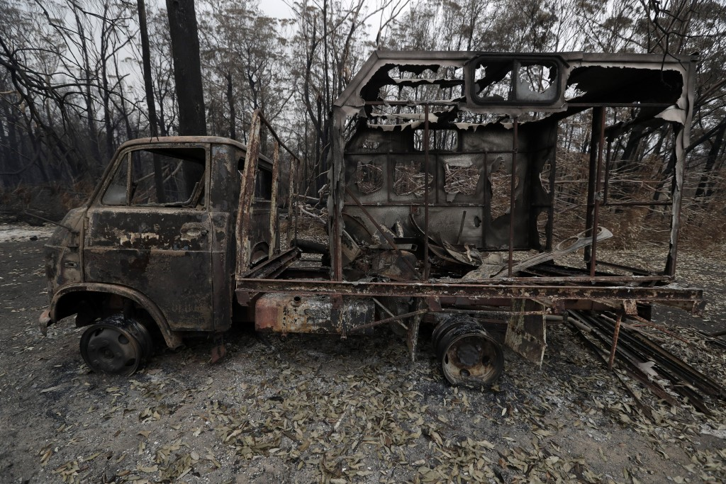 A truck is burnt out at Conjola Park, Australia, Sunday, Jan. 5, 2020, after recent wildfires ripped through the community. The deadly wildfires, whic...