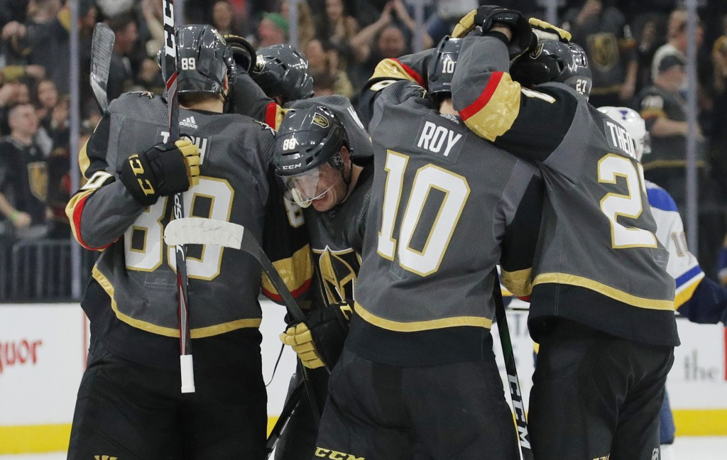 Vegas Golden Knights celebrate after defeating the St. Louis Blues during overtime of an NHL hockey game Saturday, Jan. 4, 2020, in Las Vegas. (AP Pho...
