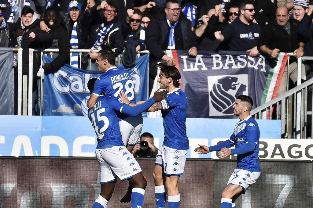 Brescia forward Mario Balotelli, left, is embraced by teammate Romulo after scoring his side's first goal during the Italian Series A soccer match bet...
