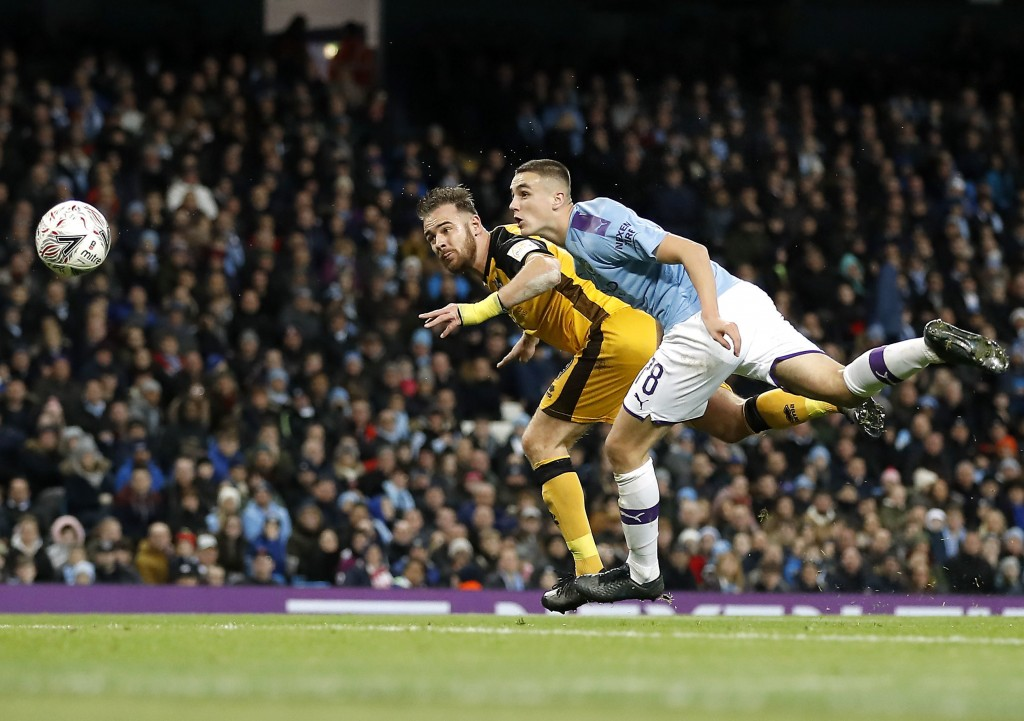 Port Vale's Tom Pope, left, scores his side's first goal of the game during the English FA Cup third round soccer match between Manchester City and Po...