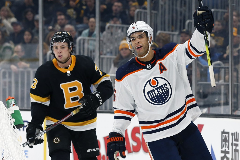 Edmonton Oilers' Darnell Nurse (25) celebrates his goal in front of Boston Bruins' Charlie McAvoy (73) during the second period on an NHL hockey game ...
