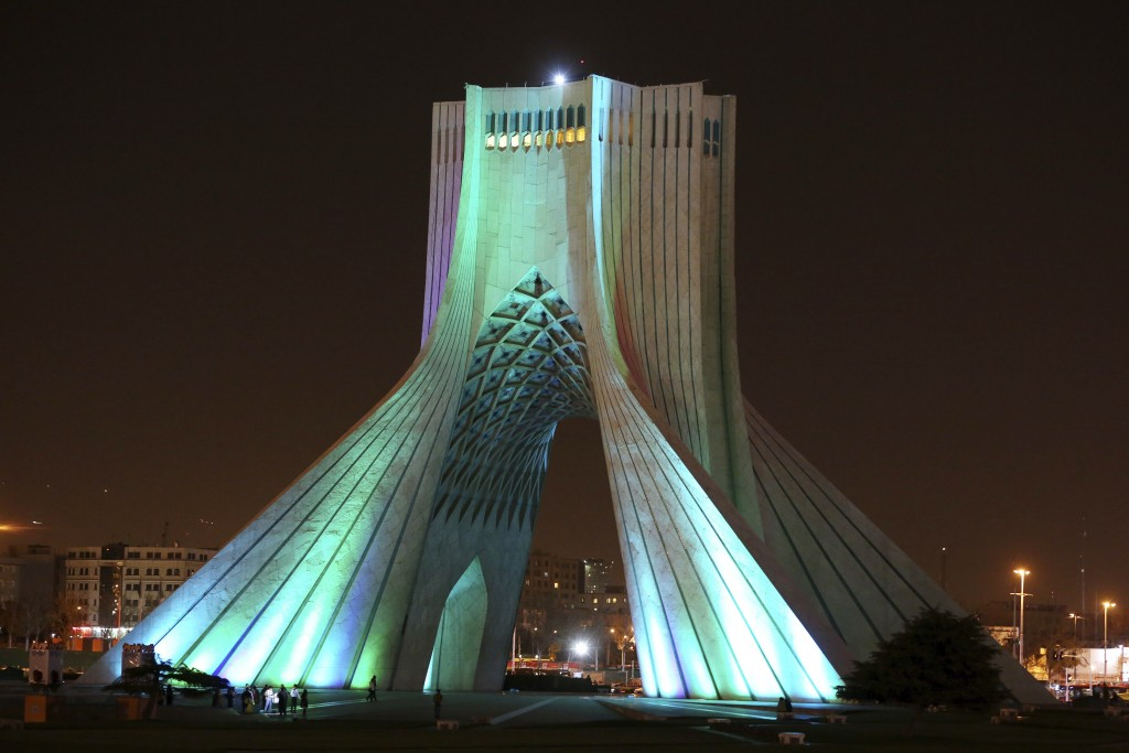 FILE— In this March 29, 2014 file photo, the Azadi (Freedom) tower is illuminated in the Iranian capital, Tehran. Iran's ancient and rich cultural lan...