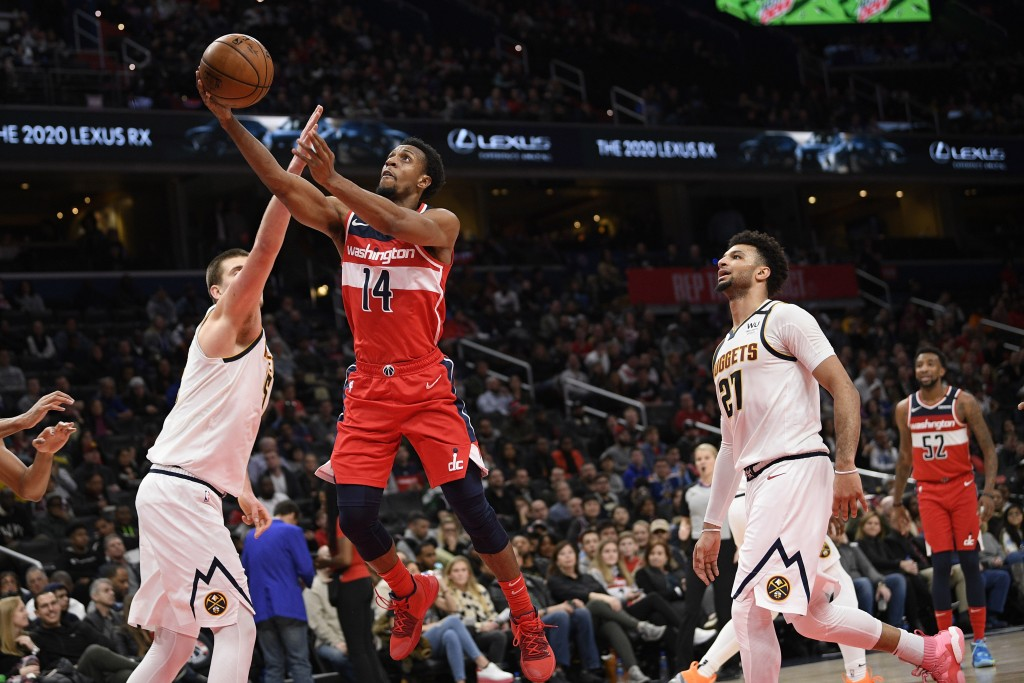 Washington Wizards guard Ish Smith (14) goes to the basket between Denver Nuggets guard Jamal Murray (27) and center Nikola Jokic, left, during the se...