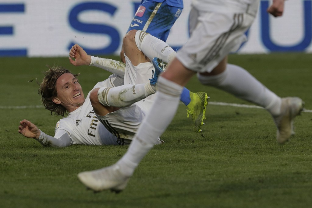 Real Madrid's Luka Modric reacts after scoring his side's third goal during a Spanish La Liga soccer match between Getafe and Real Madrid at the Colis...