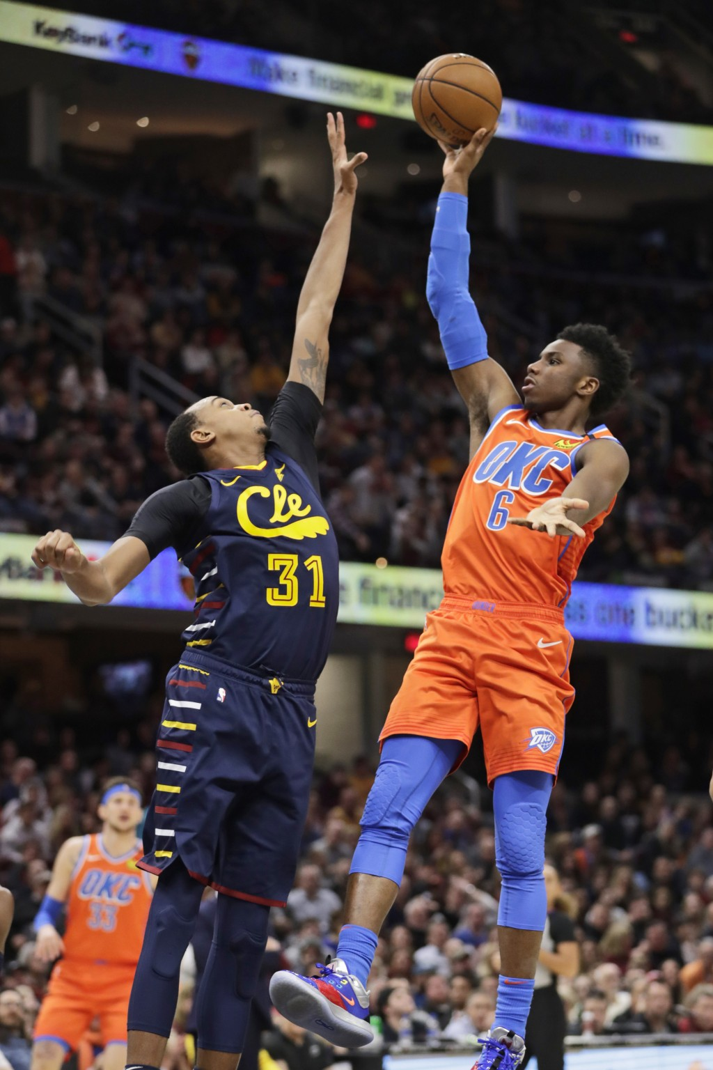 Oklahoma City Thunder's Hamidou Diallo (6) drives to the basket against Cleveland Cavaliers' John Henson (31) in the second half of an NBA basketball ...
