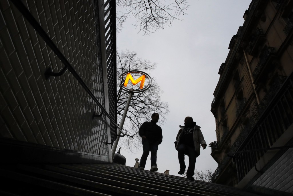CORRECTING OBJECT NAME TO FRANCE STRIKES - Commuters enter the Paris subway during the 32nd day of transport strikes, Sunday, Jan. 5, 2020. With more ...