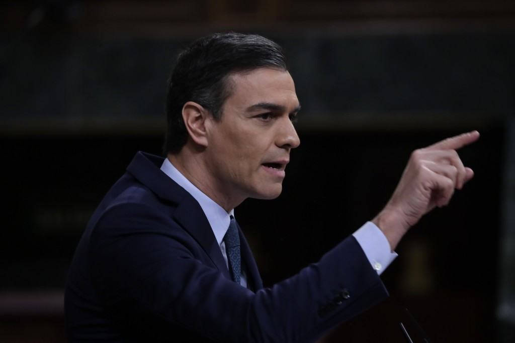 Spain's interim Prime Minister Pedro Sanchez speaks at the Spanish Parliament in Madrid, Spain, Sunday, Jan. 5, 2020. Sanchez is facing the first of t...