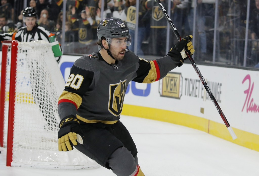Vegas Golden Knights center Chandler Stephenson (20) celebrates after scoring against the St. Louis Blues during overtime of an NHL hockey game Saturd...