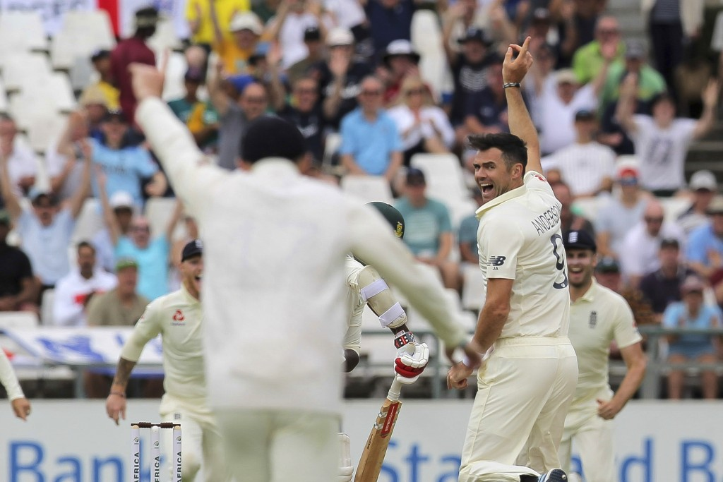 England bowler Jimmy Anderson celebrates the wicket of Kagiso Rabada of the first ball of day three of the second cricket test between South Africa an...