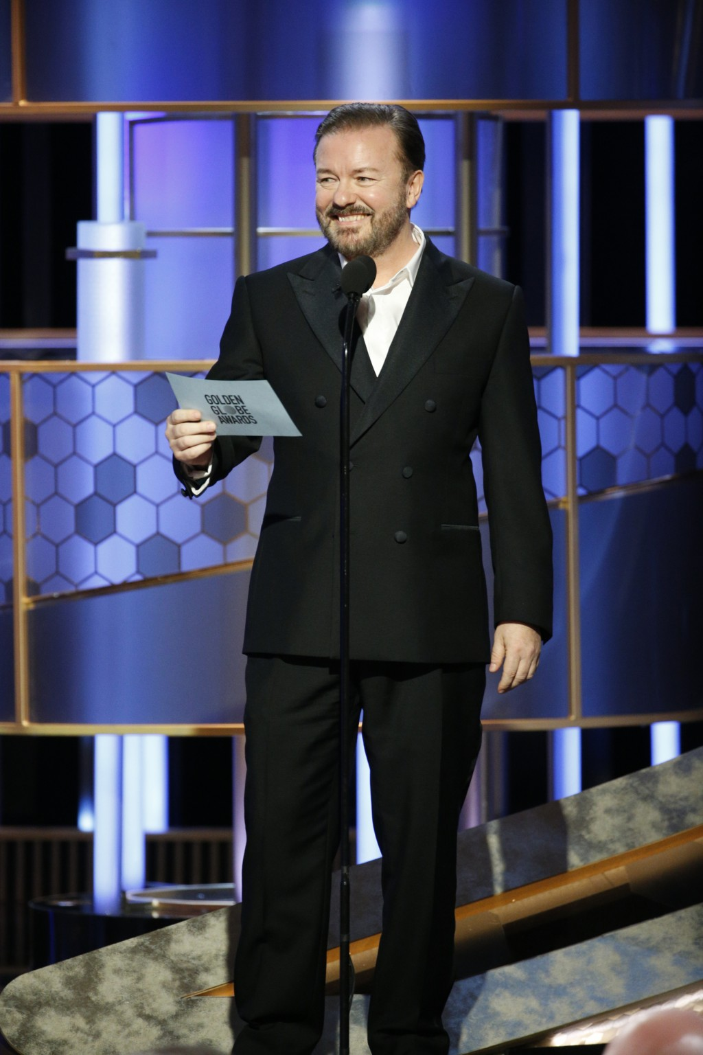 This image released by NBC shows host Ricky Gervais at the 77th Annual Golden Globe Awards at the Beverly Hilton Hotel in Beverly Hills, Calif., on Su...