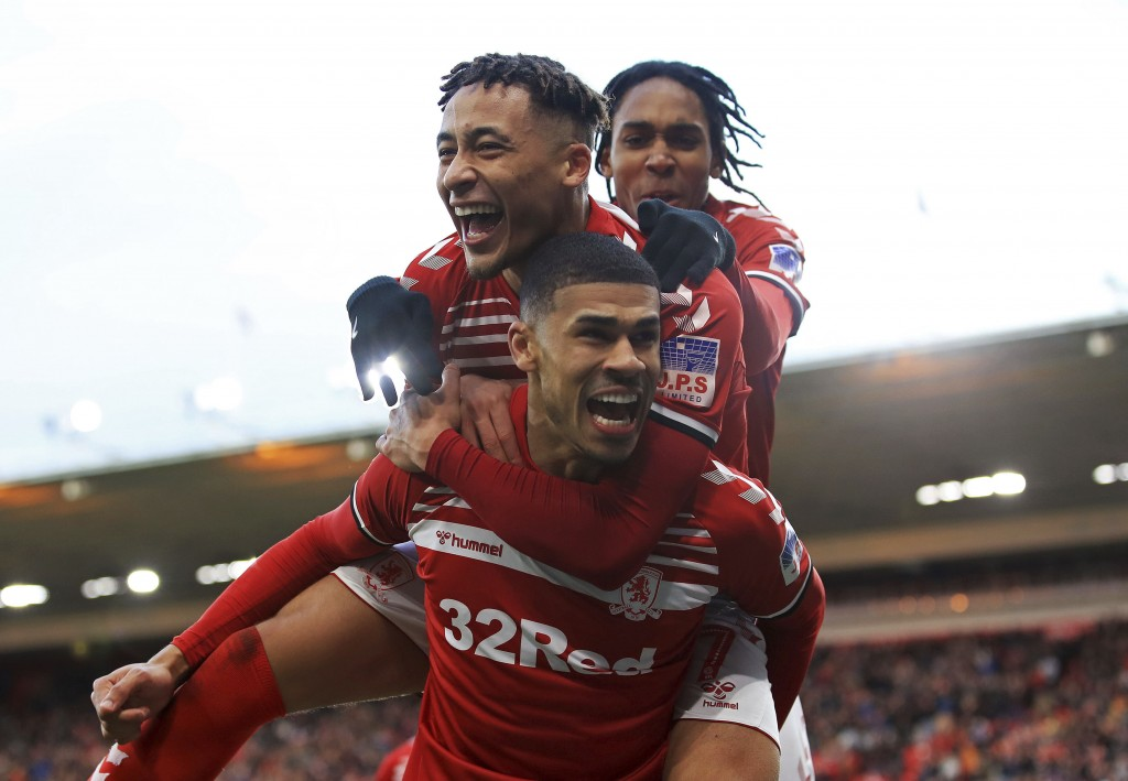 Middlesbrough's Ashley Fletcher celebrates scoring his side's first goal of the game with Marcus Tavernier, left, during their game against Tottenham,...