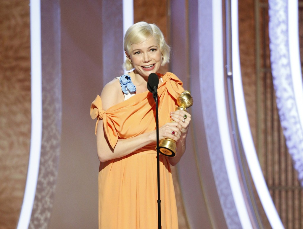 """This image released by NBC shows Michelle Williams accepting the award for best actress in a limited series or TV movie for her role in """"Fosse/Verdon""""..."""