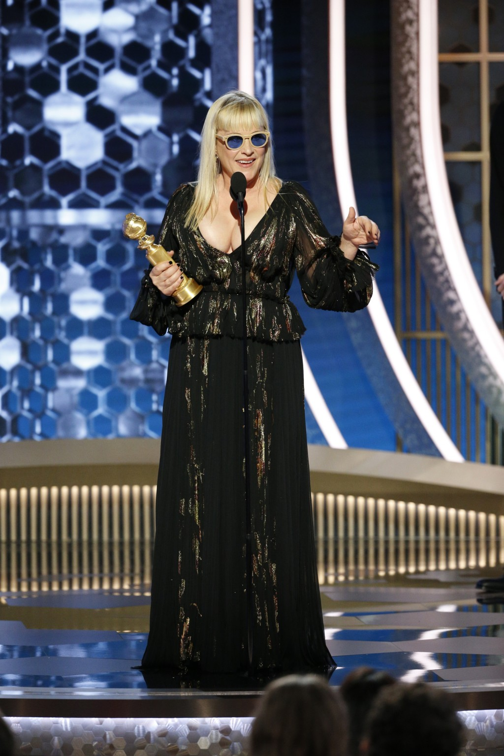 This image released by NBC shows Patricia Arquette accepting the award for best supporting actress in a series, limited series or TV movie for her rol...