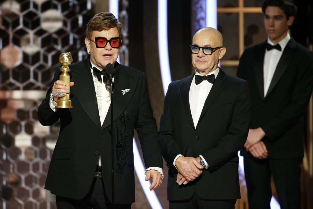 """This image released by NBC shows Elton John, left, and Bernie Taupin accepting the award for best original song for """"I'm Gonna Love Me Again"""" from """"Ro..."""