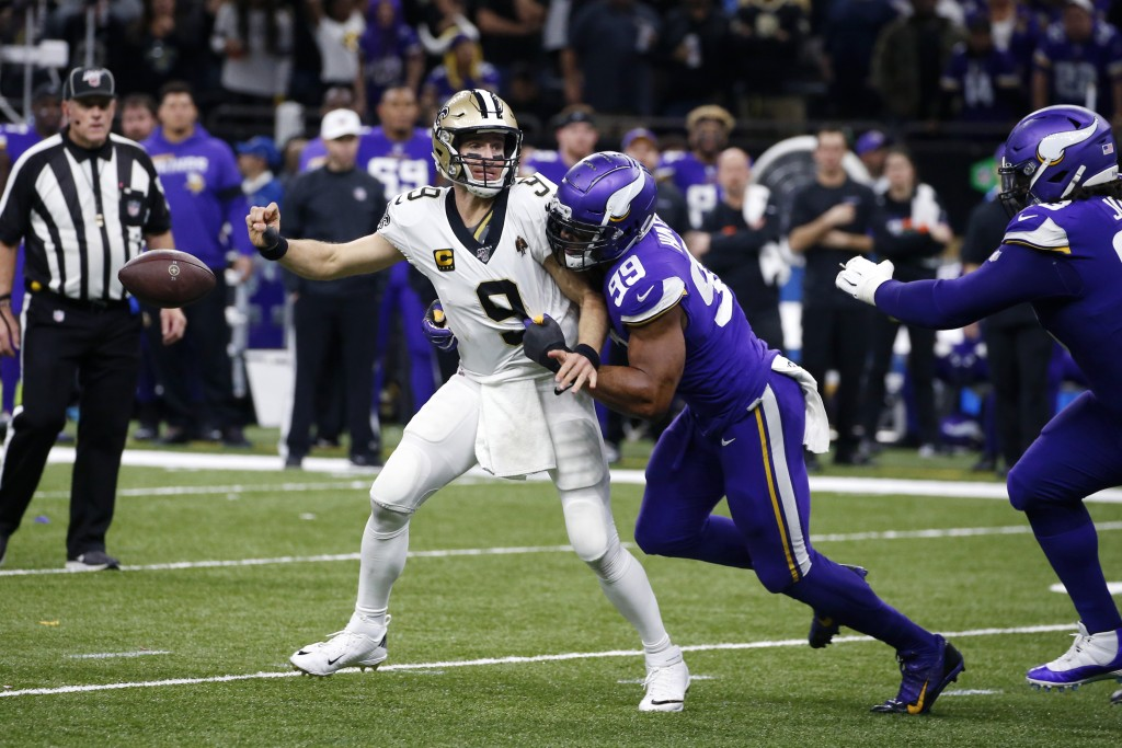 New Orleans Saints quarterback Drew Brees (9) fumbles as he is hit by Minnesota Vikings defensive end Danielle Hunter (99) in the second half of an NF...