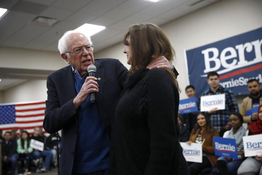 Democratic presidential candidate Sen. Bernie Sanders, I-Vt., speaks with potential caucus-goer Kendra Breitsprecher, of Dayton, Iowa, after Breitspre...